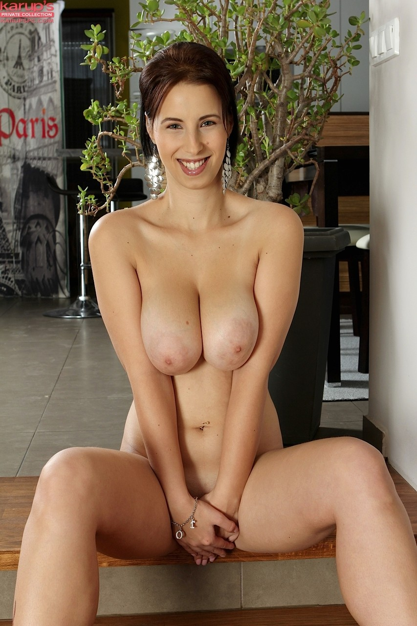 Hungarian female Chrissy Harris reveals her nice melons while getting naked