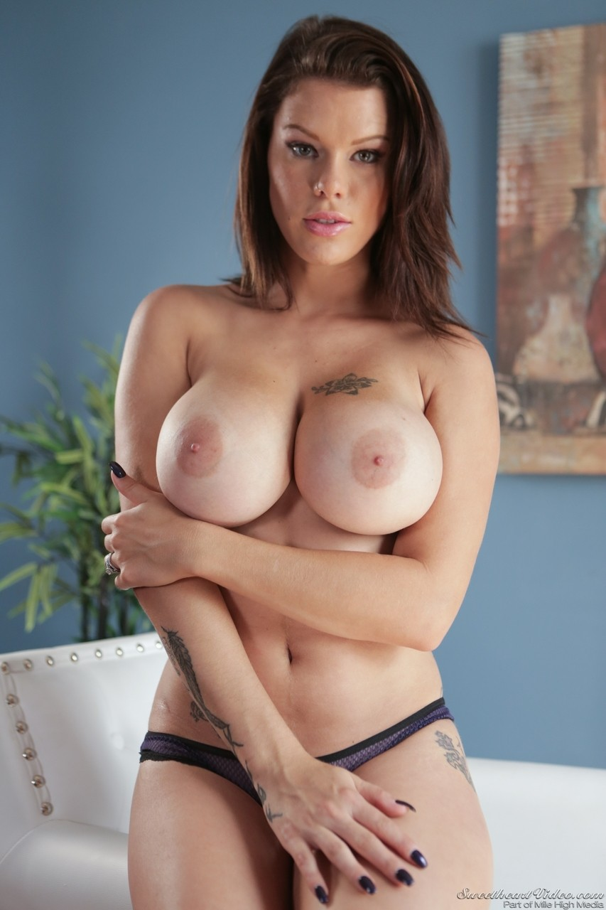 Brunette MILF Peta Jensen reveals her big tits as she strips off her clothes