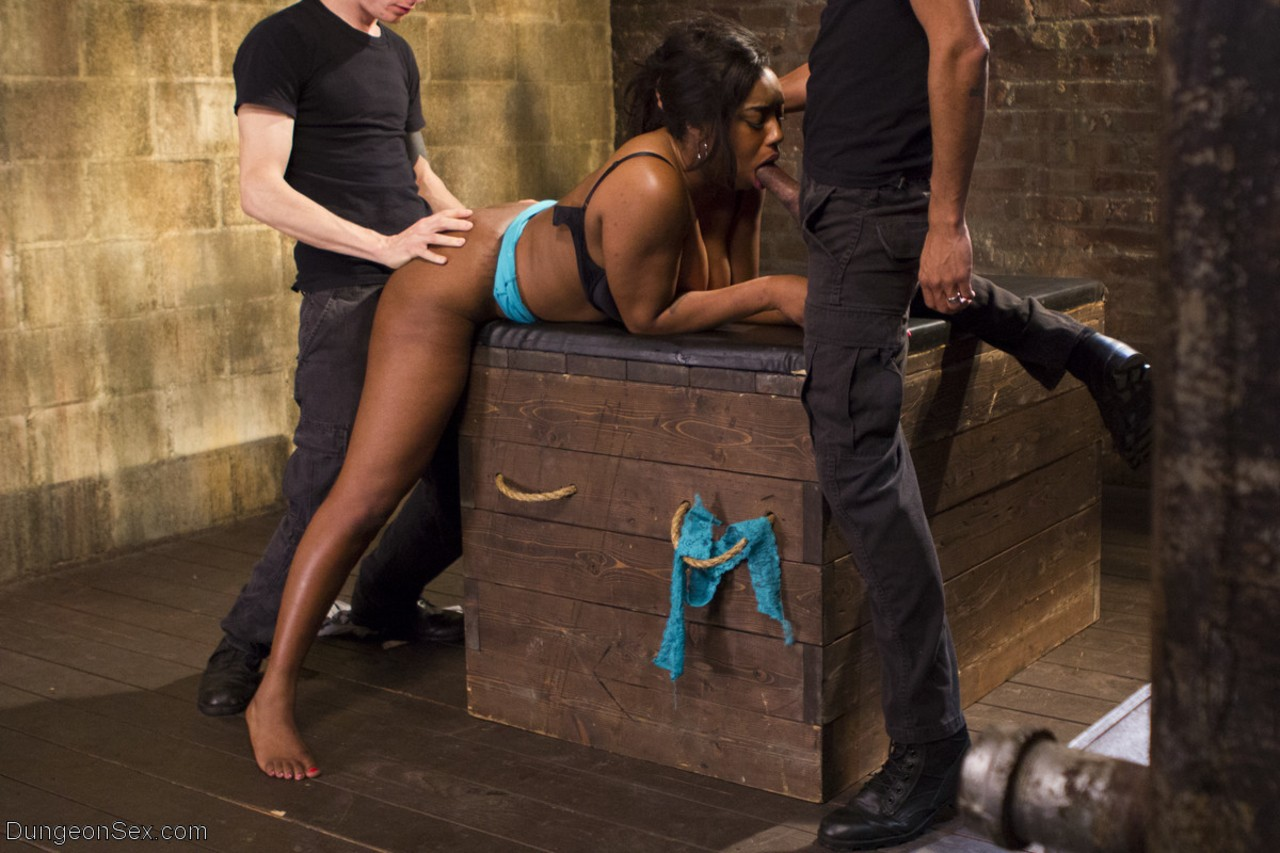 Black chick Lisa Tiffian is restrained with rope for the pleasure of white men