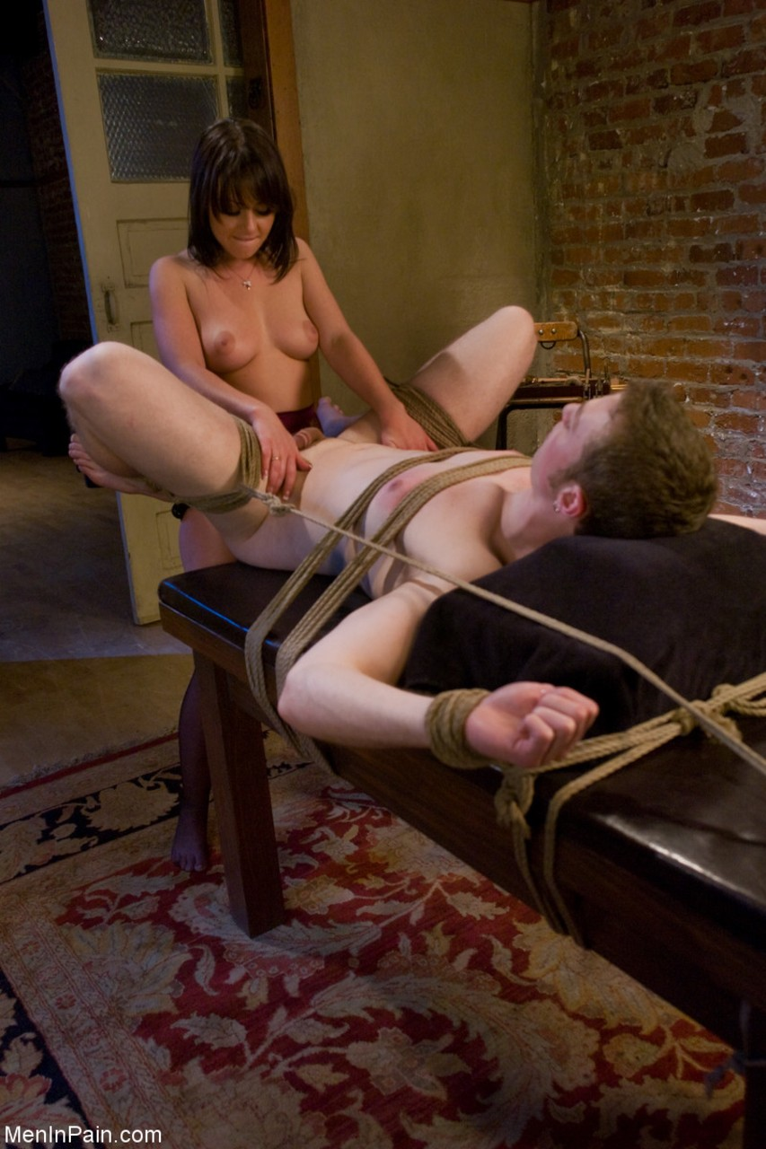Brunette female Penny Flame butt fucks her restrained man slave