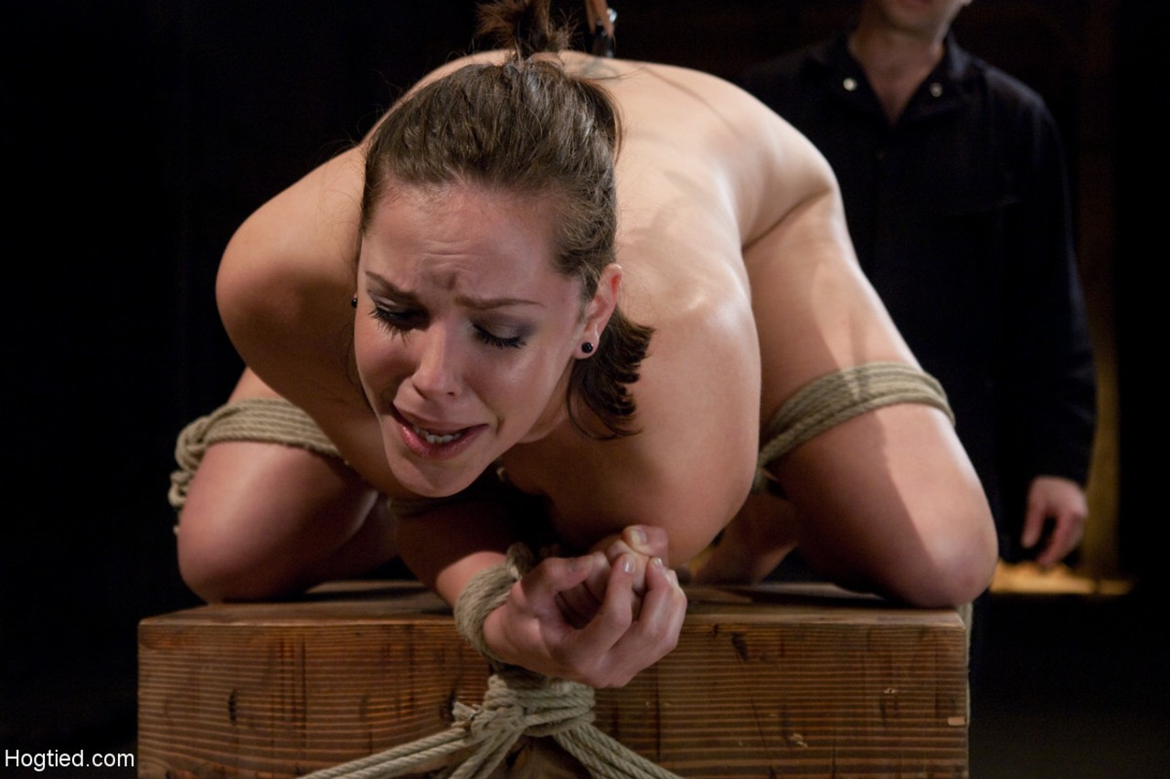 Naked female Bobbi Starr screams out during forced machine fucking in ropes