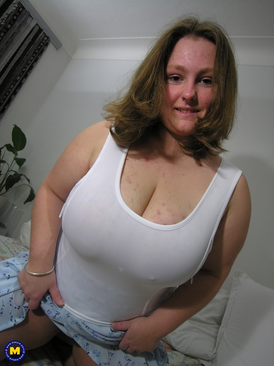 Fat amateur exposes her huge breasts before pulling out a sex toy