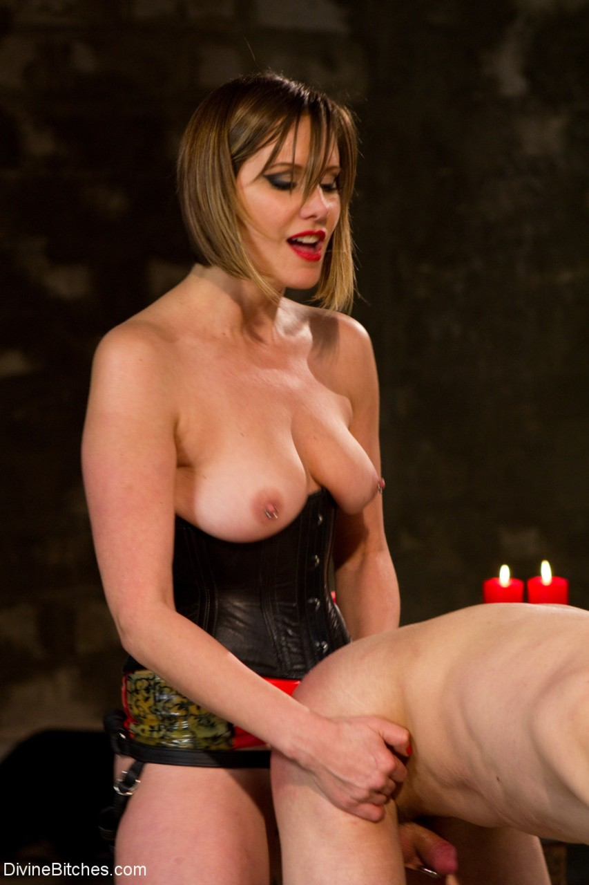 Leggy blonde chick brutally pegs and tramples a male sub in her dungeon