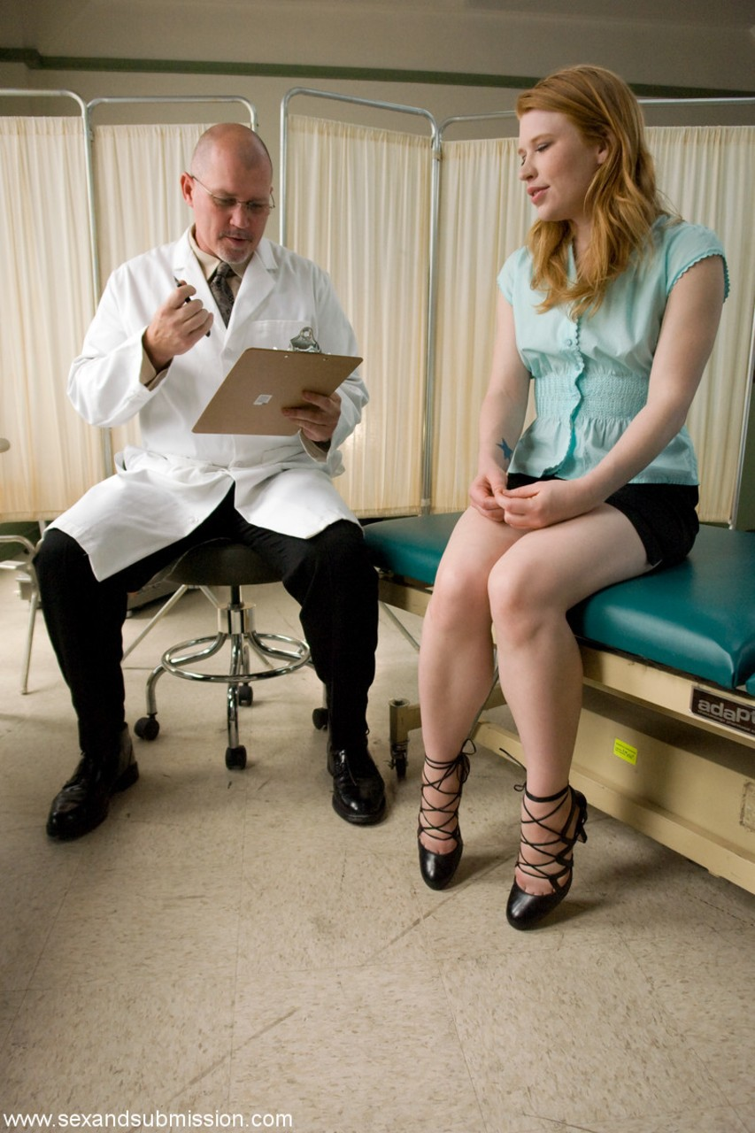 Redhead chick Madison Young dons a rubber mask for sex games with kinky doctor