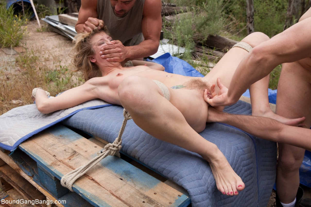 Blonde female Chastity Lynn is tied up and gangbanged somewhere in the woods