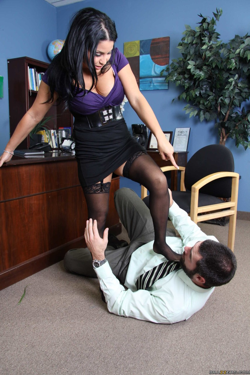 Brunette business woman makes a male employee eat out her pussy