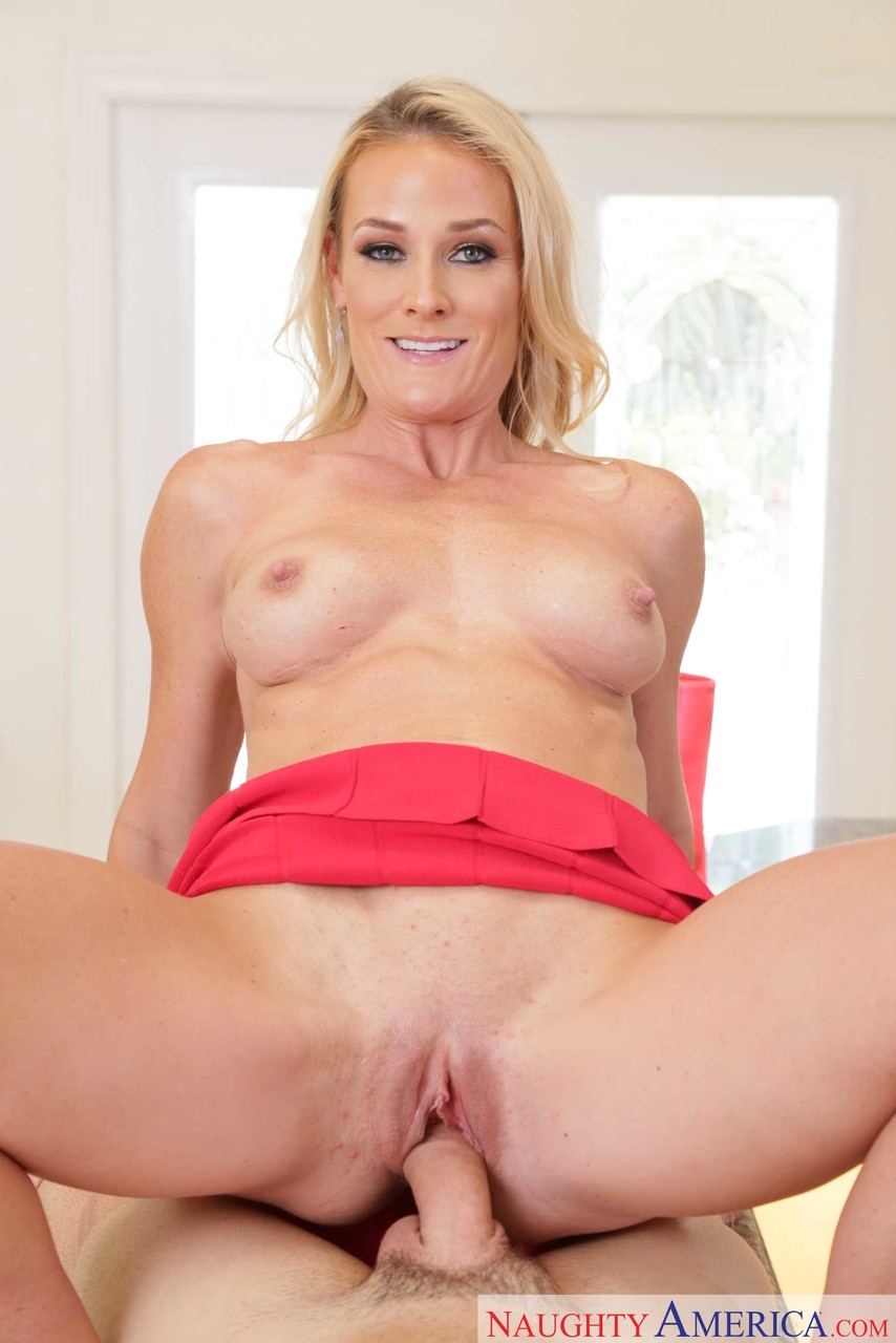 Horny blonde wife Sydney Hail seduces her sons best friend in a red skirt