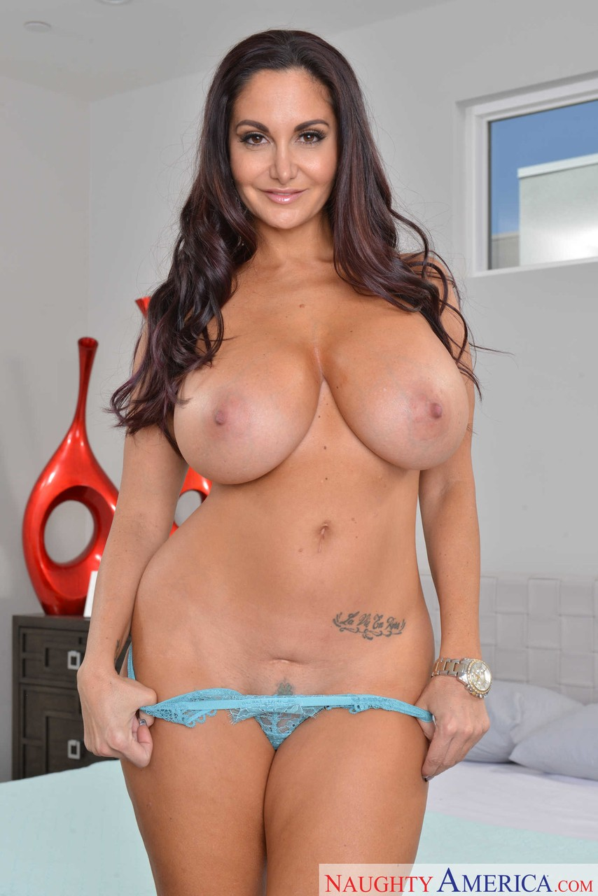 Busty French brunette Ava Addams exposes her giant tits in her bedroom