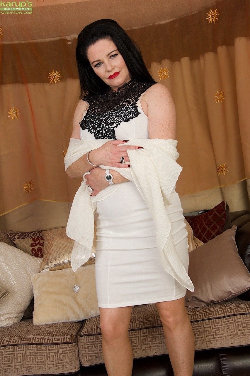 Dark haired British female Sarah Kelly pleasures herself with fingers and toys
