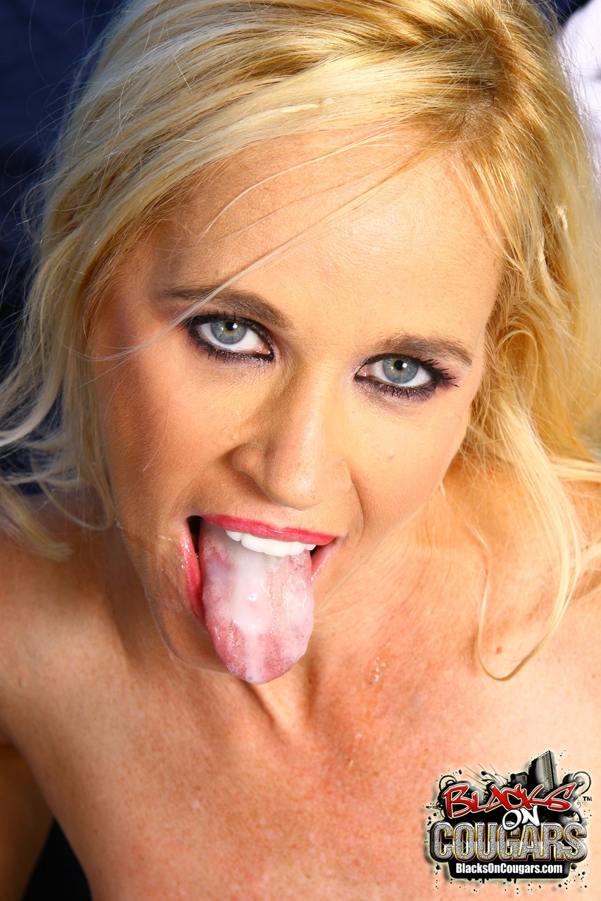 Blonde cougar Tabitha enjoys a big black cock before getting cum on her face