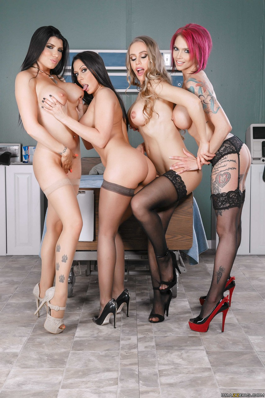 4 females in high heeled shoes and stockings expose their knockers