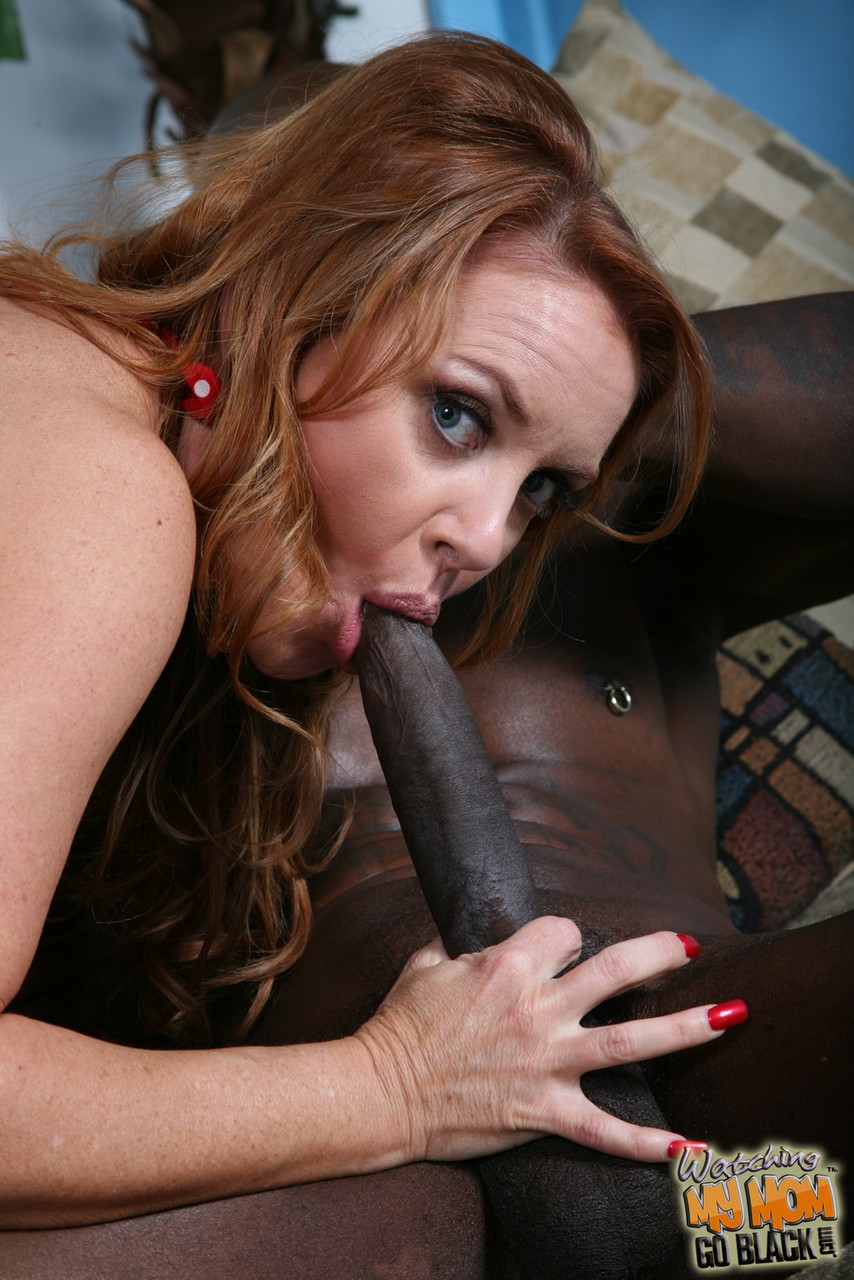 Busty Janet Mason gets her love tunnel penetrated by two big black cocks