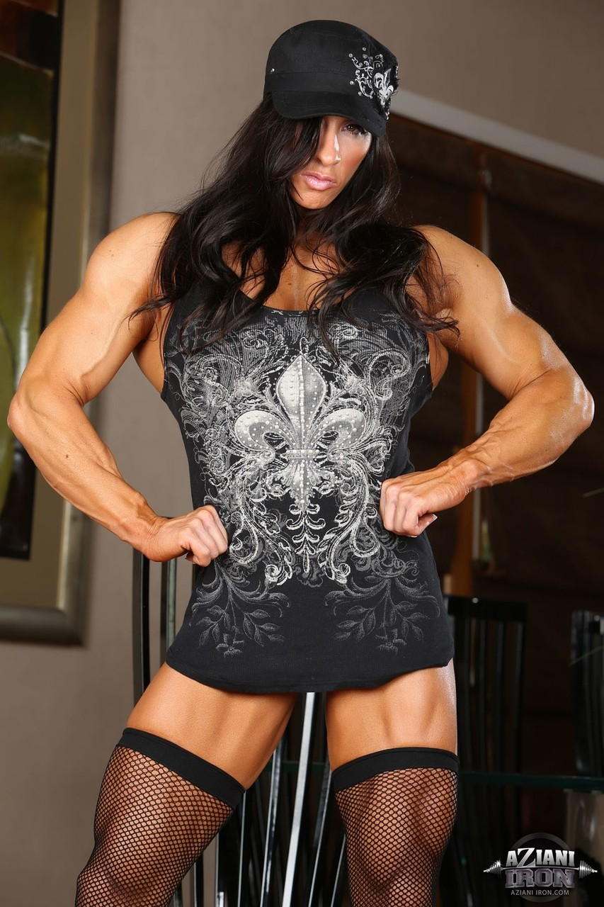 Bodybuilder Angela Salvagno shows her shaved cunt and masturbates with a toy