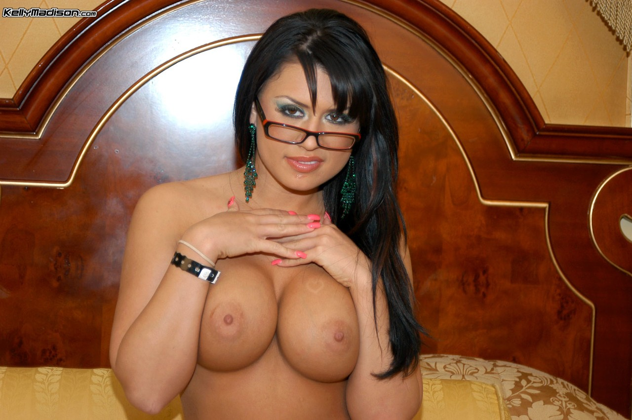 Solo model with dark hair undresses to masturbate with her glasses on