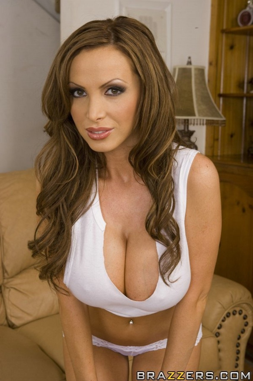 Fit solo model Nikki Benz unleashes her hooters as she strips naked