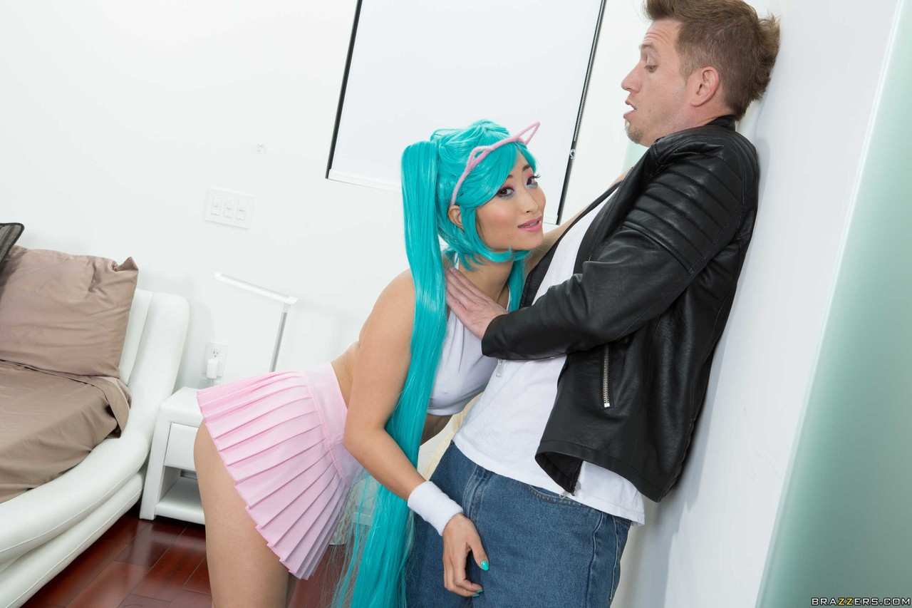 Asian cutie Ayumu Kase seduces a white boy in her cosplay outfit