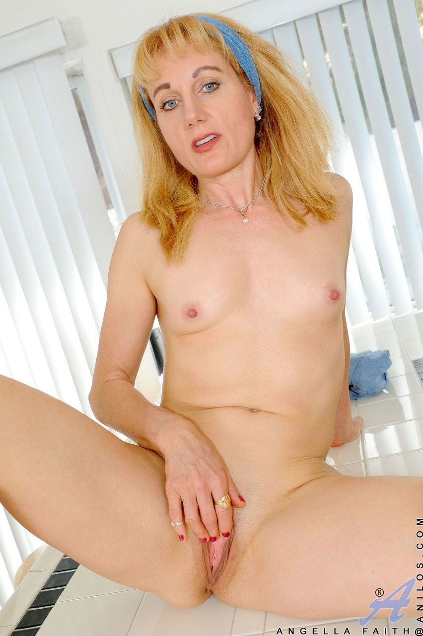 Mature Angella Faith loves to play with her snatch after stripping