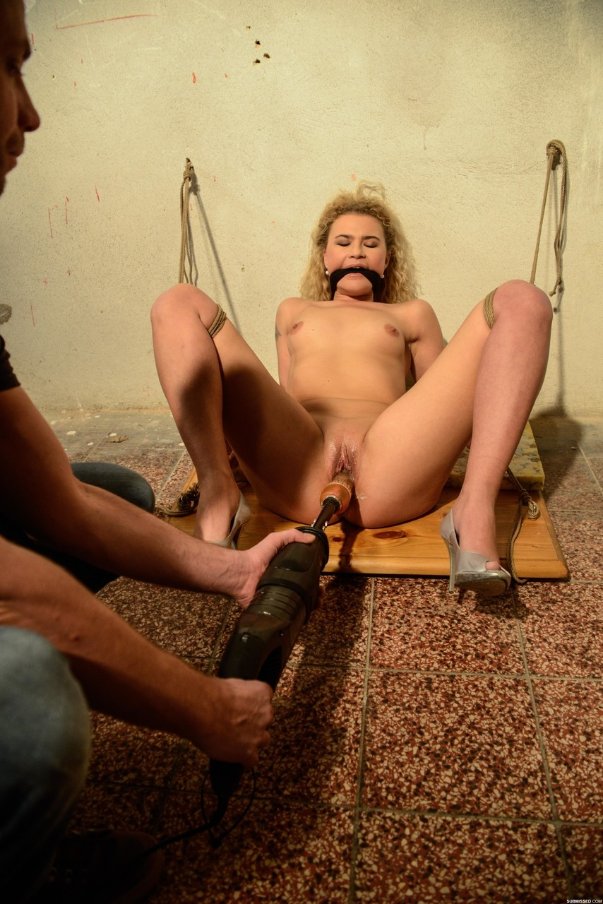 Bound and gagged chick Angel Diamonds endures a machine-fuck against her will