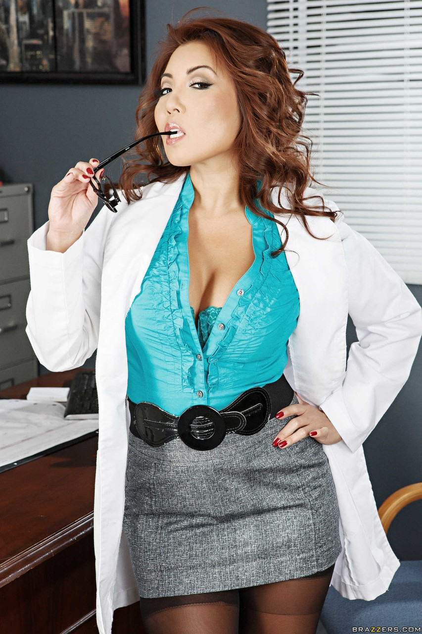 Asian doctor Akira Lane takes off her glasses and then her clothes