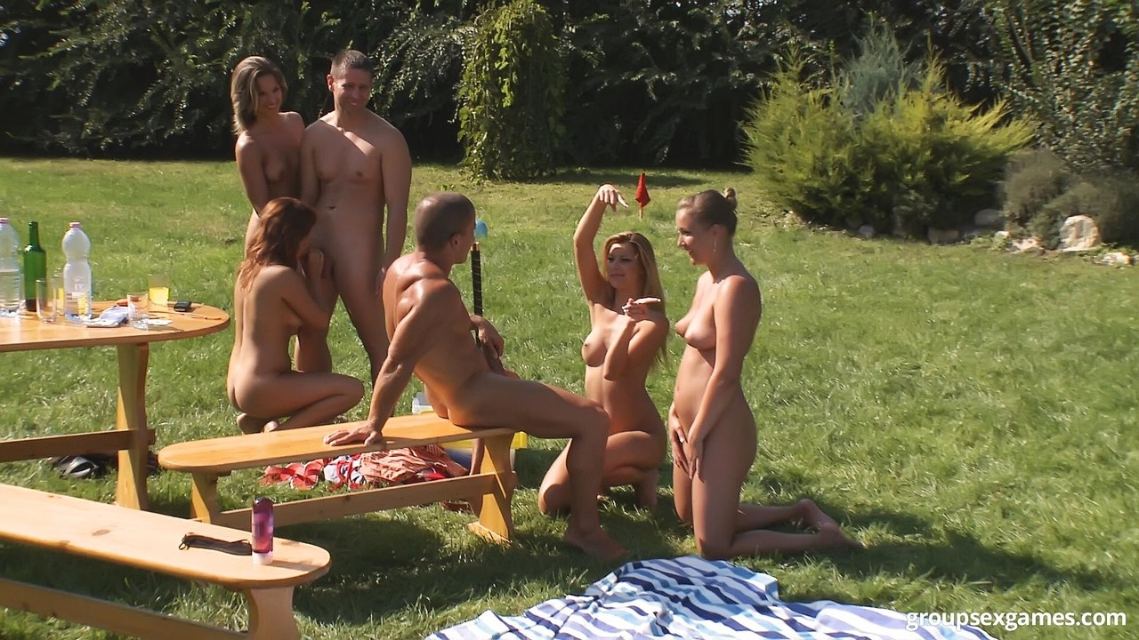 Open minded couples get together for sexually oriented games in a big backyard