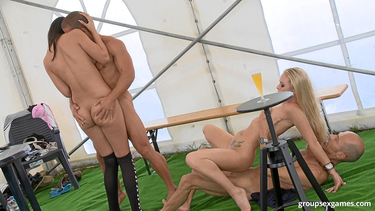 Slender beauties Flavia and Diana Stewart enjoy foursome in a big tent