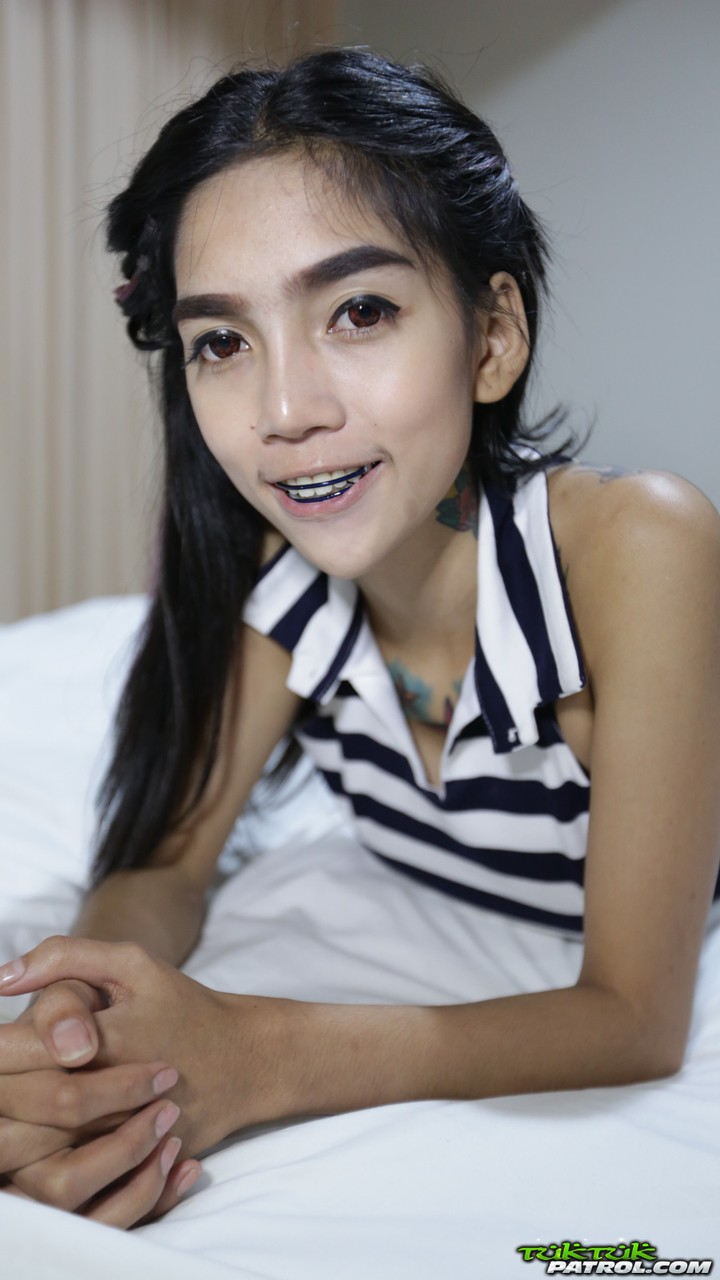 ... Skinny Thai girl with tattoos and braces makes her nude modelling debut  ...
