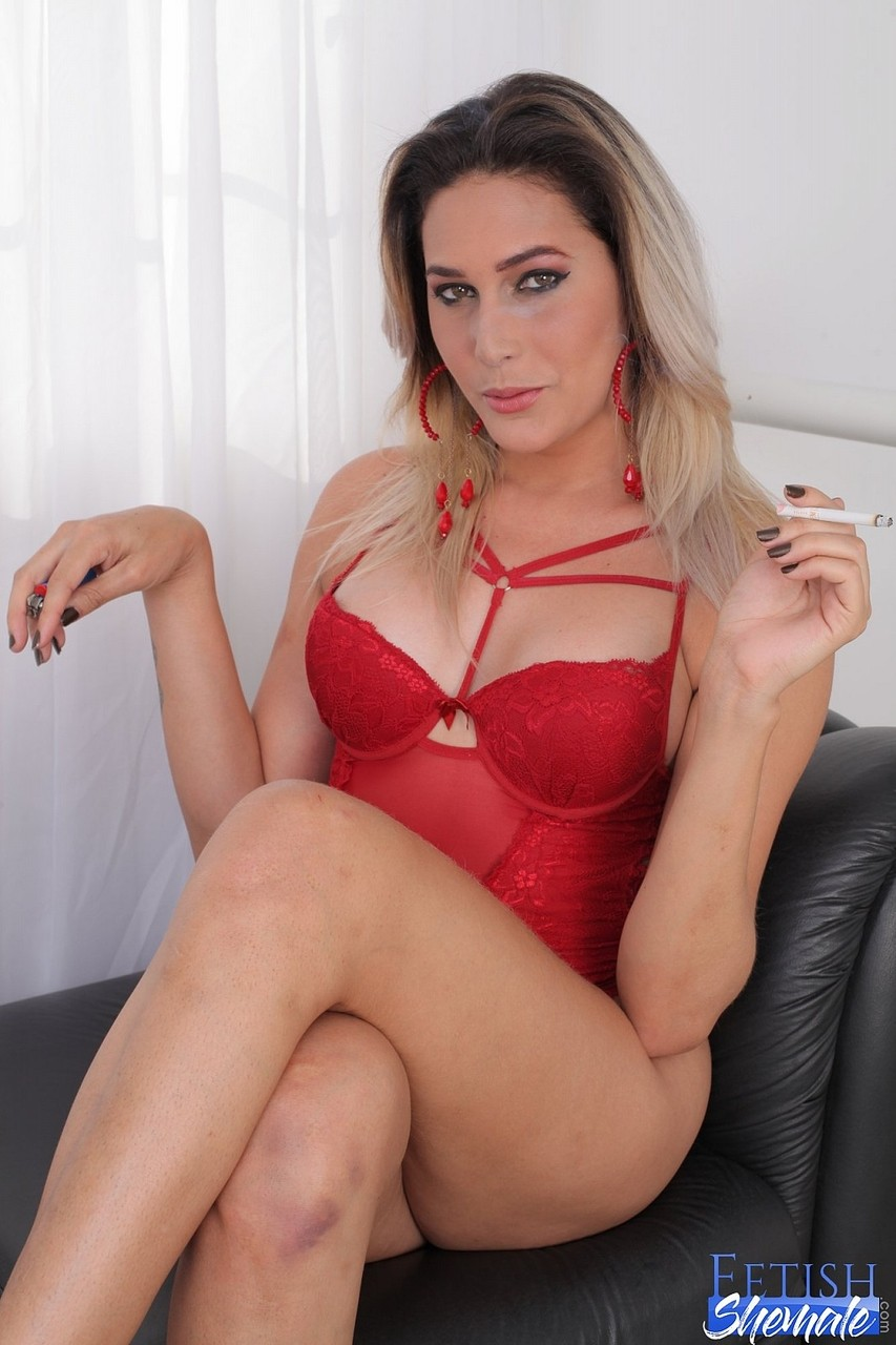 Attractive shemale Bellatrix Fontes posing in her sexy red lingerie