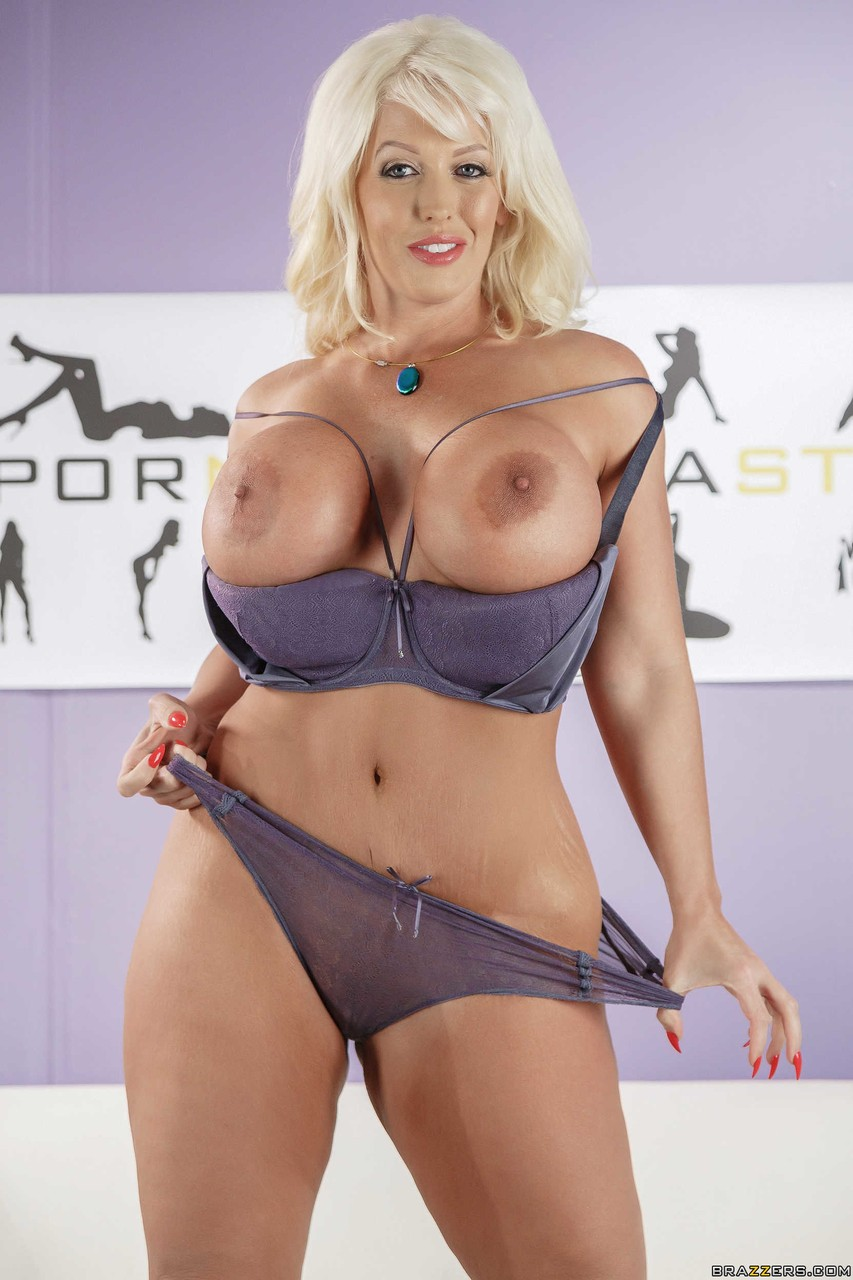 Curvaceous female Alura Jenson reveals her huge boobs as she gets naked