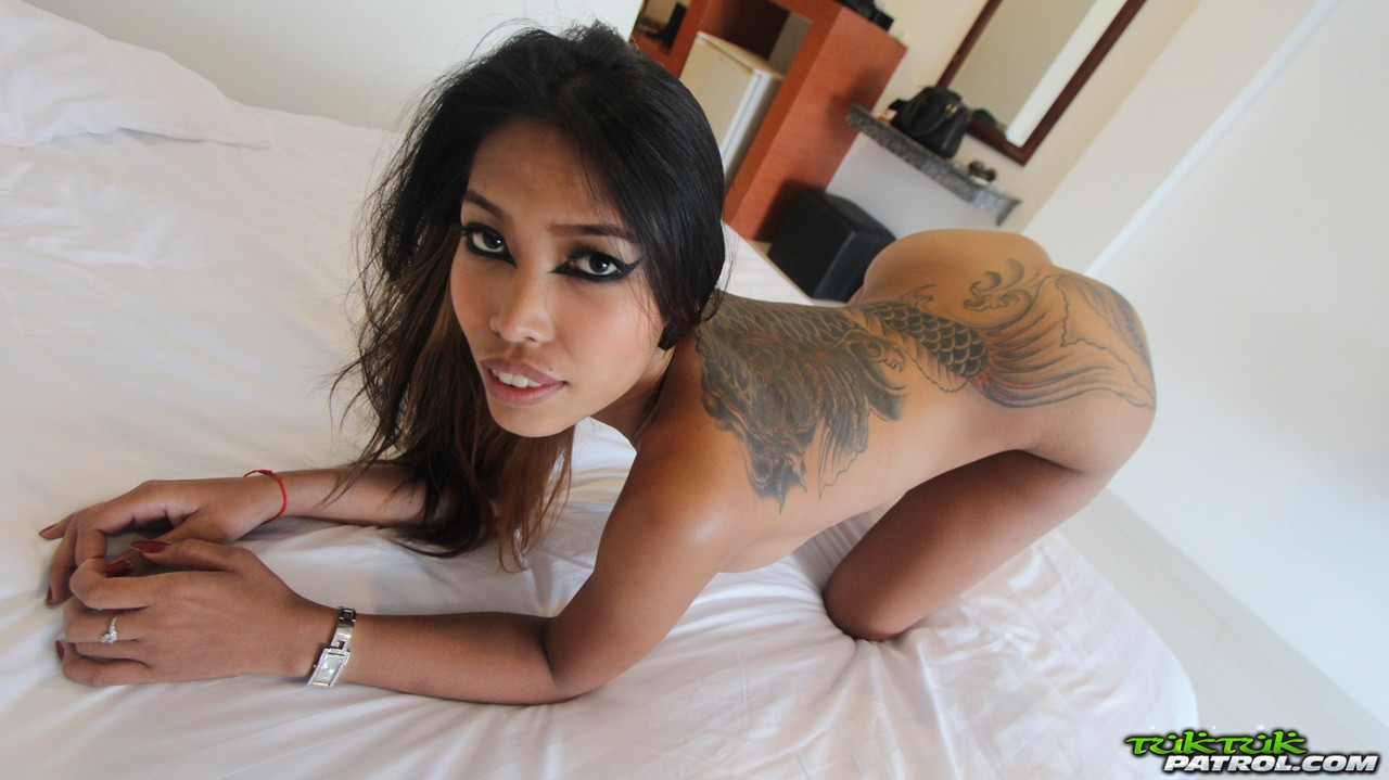 Busty Thai girl with a back tattoo leaks sperm from her pussy after fucking