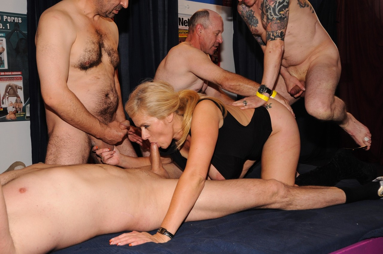 Big boobed blonde chick offers up her pierced twat to all cocks in a gangbang
