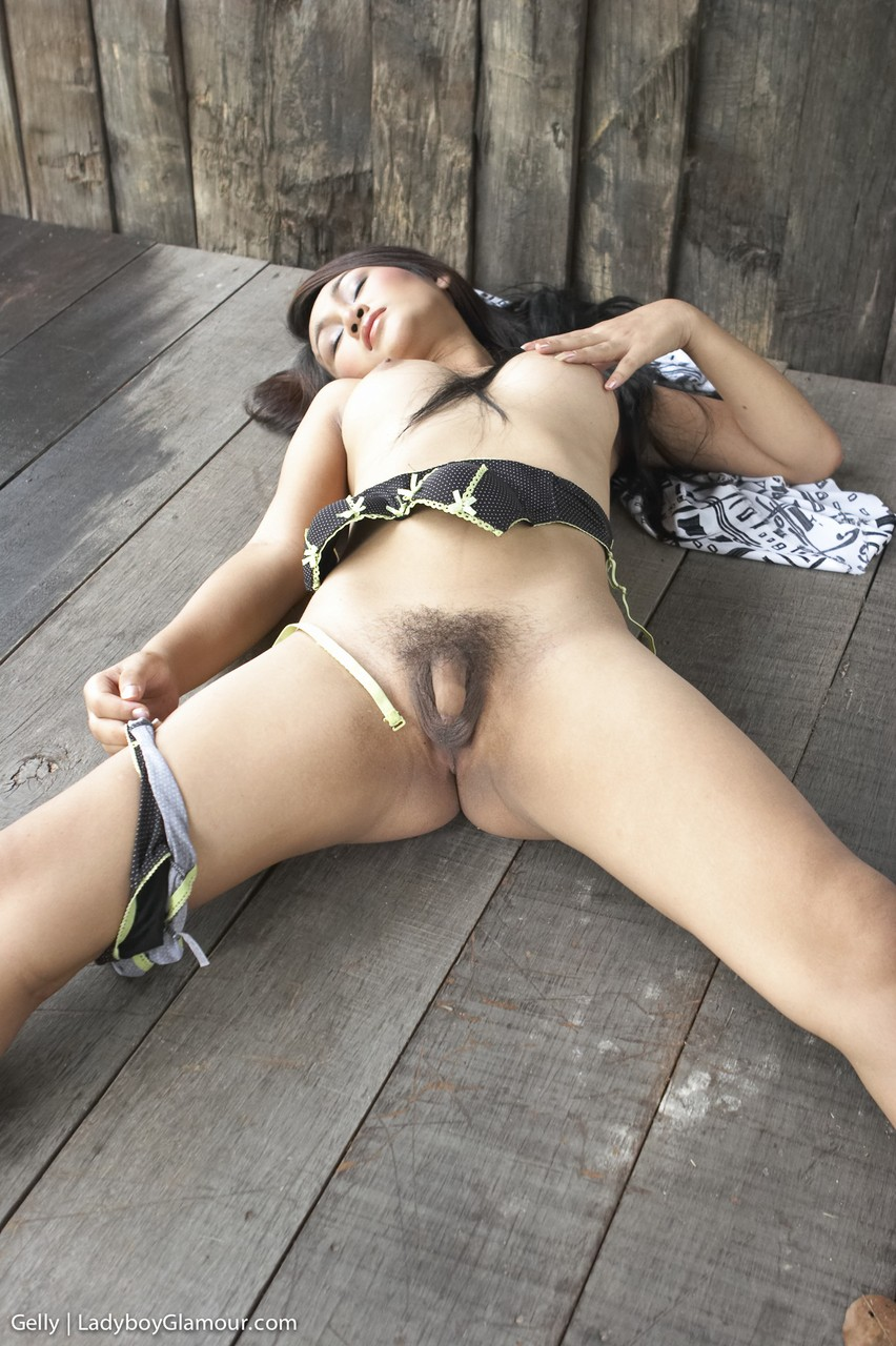 Cute Gelly strips down naked and rubs her super small penis outdoors