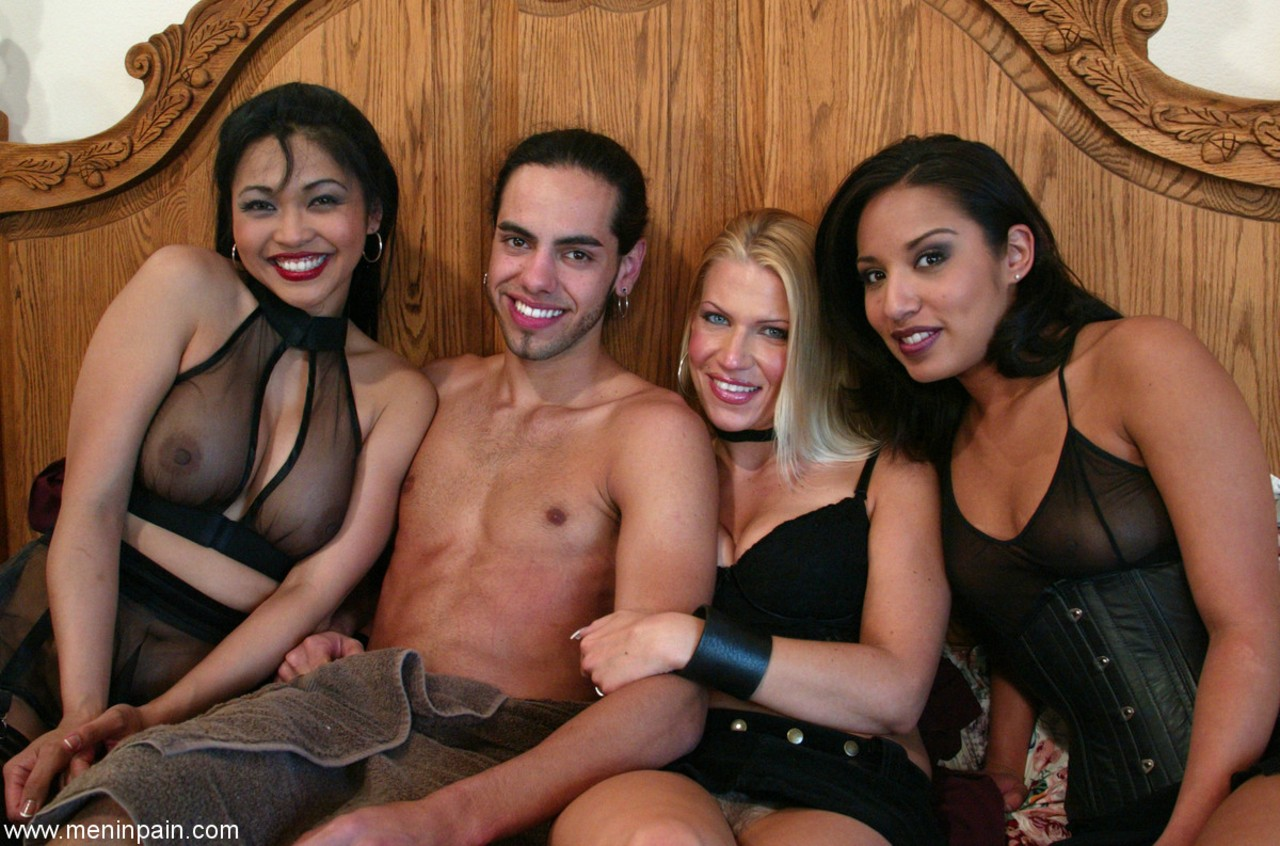 3 kinky females hold a man down and take turns pegging his virgin ass