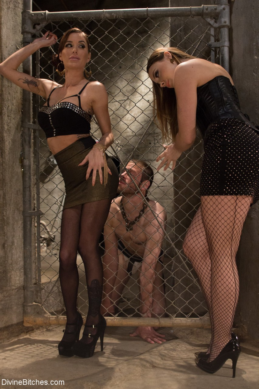Sexy dominant ladies torture and humiliate their cute slave in the dungeon