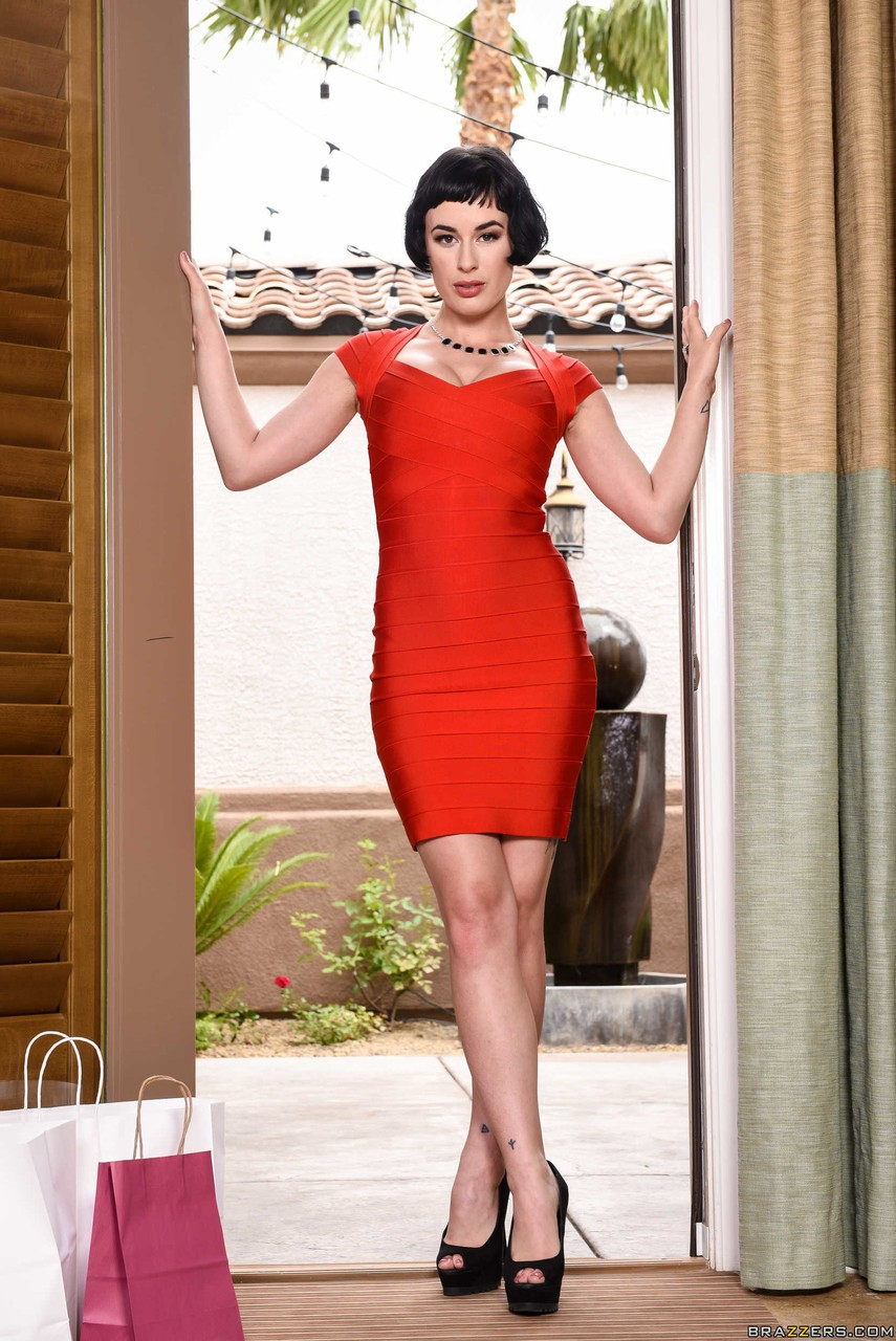 tall female olive glass doffs a red dress and lingerie to