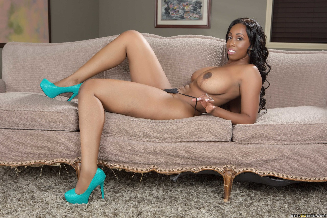 American chick Codi Bryant unleashes her big black tits as she gets naked