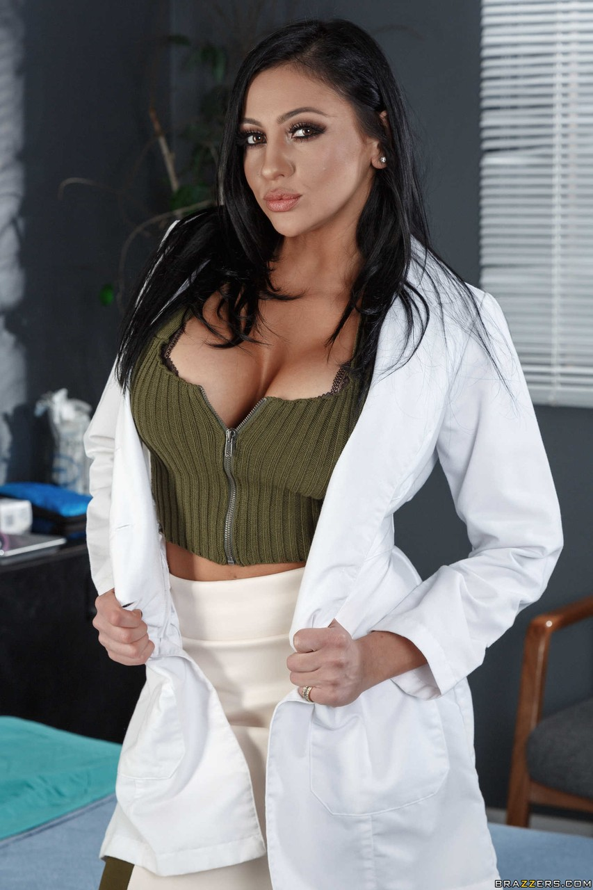 Female Doctor Audrey Bitoni Doffs Her Lab Coat As She Strips To Her