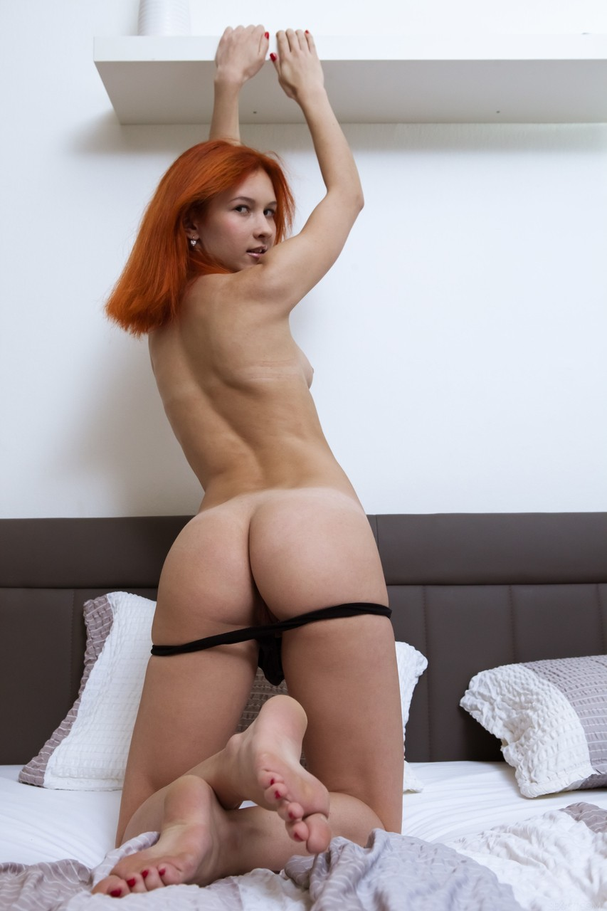 Pretty redhead babe Ambre spreads her legs and fingers herself passionately