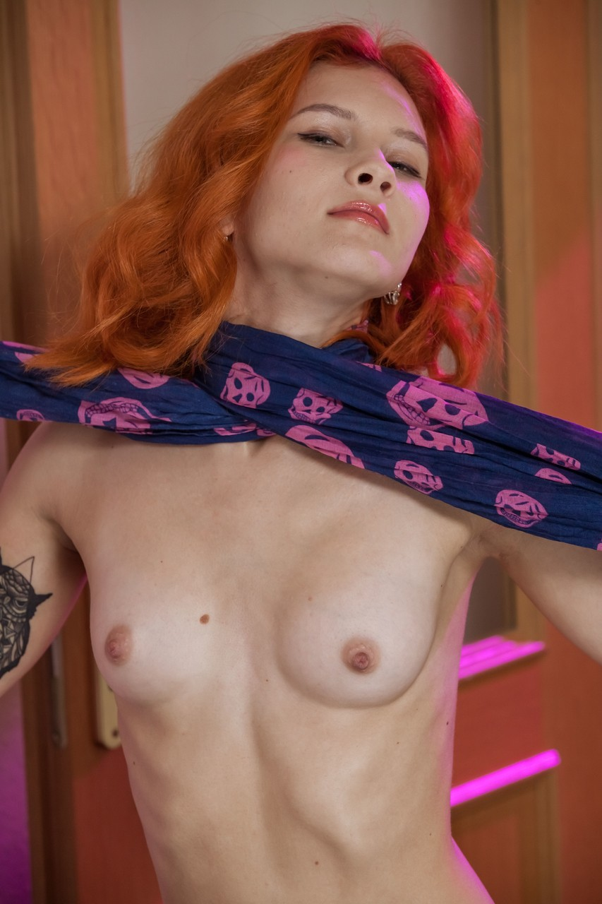Kinky redhead Ambre ties herself up with a scarf while posing nude
