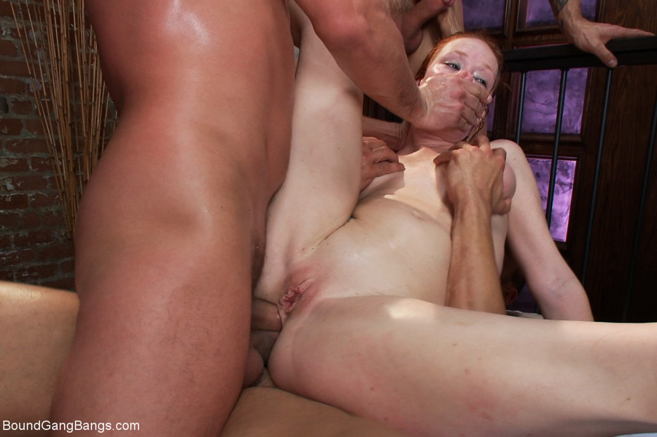 Natural redhead Audrey Hollander makes her XXX return in a hardcore gangbang
