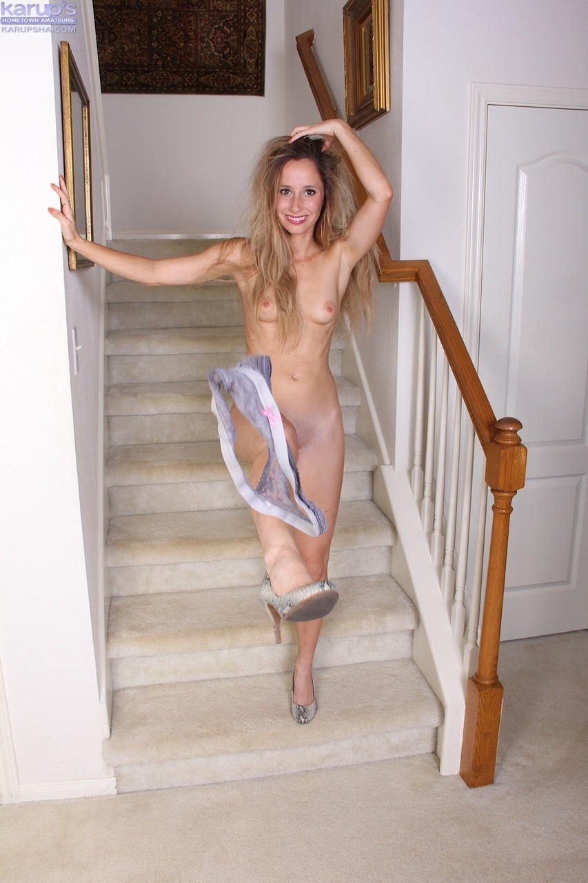 Solo girl Piper Candlewick kicks off her panties for nude poses on stairs