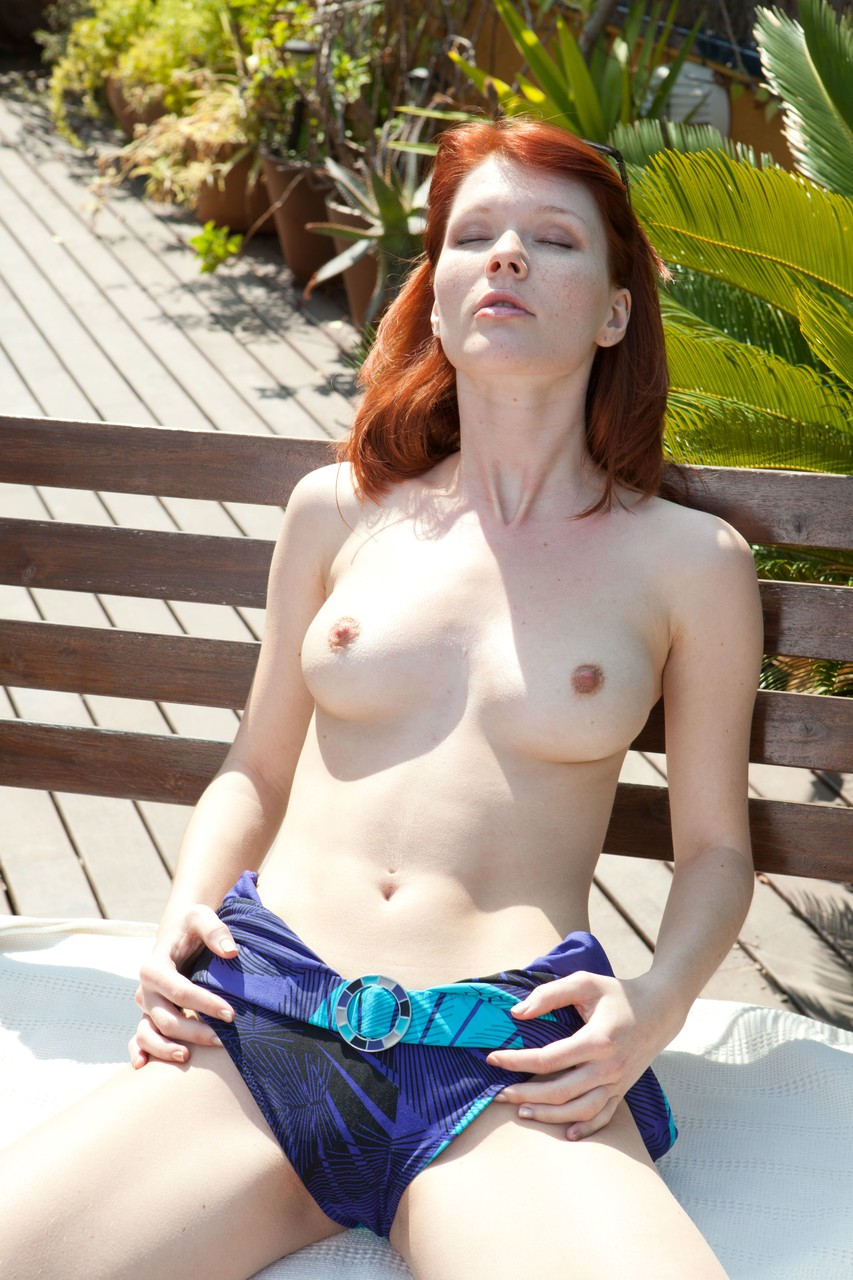 ... Red hair, tits, and pale pussy of Mia Sollis look awesome in the  sunrays ...