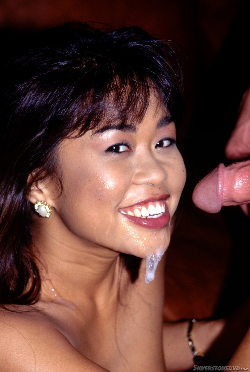 Asian girl Leanni Lei drips sperm from her chin after giving a blowjob