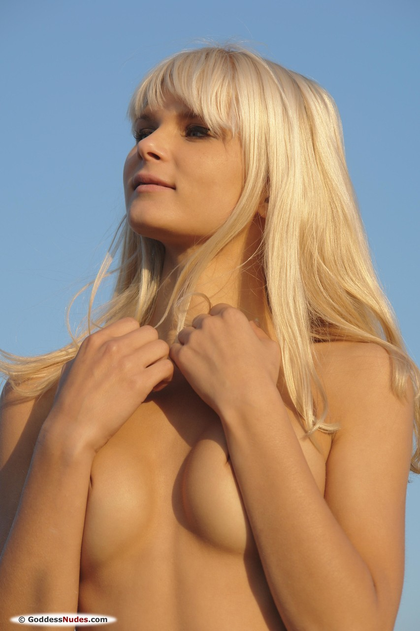 Long-legged blonde girl Alicia A strips down and poses in the field