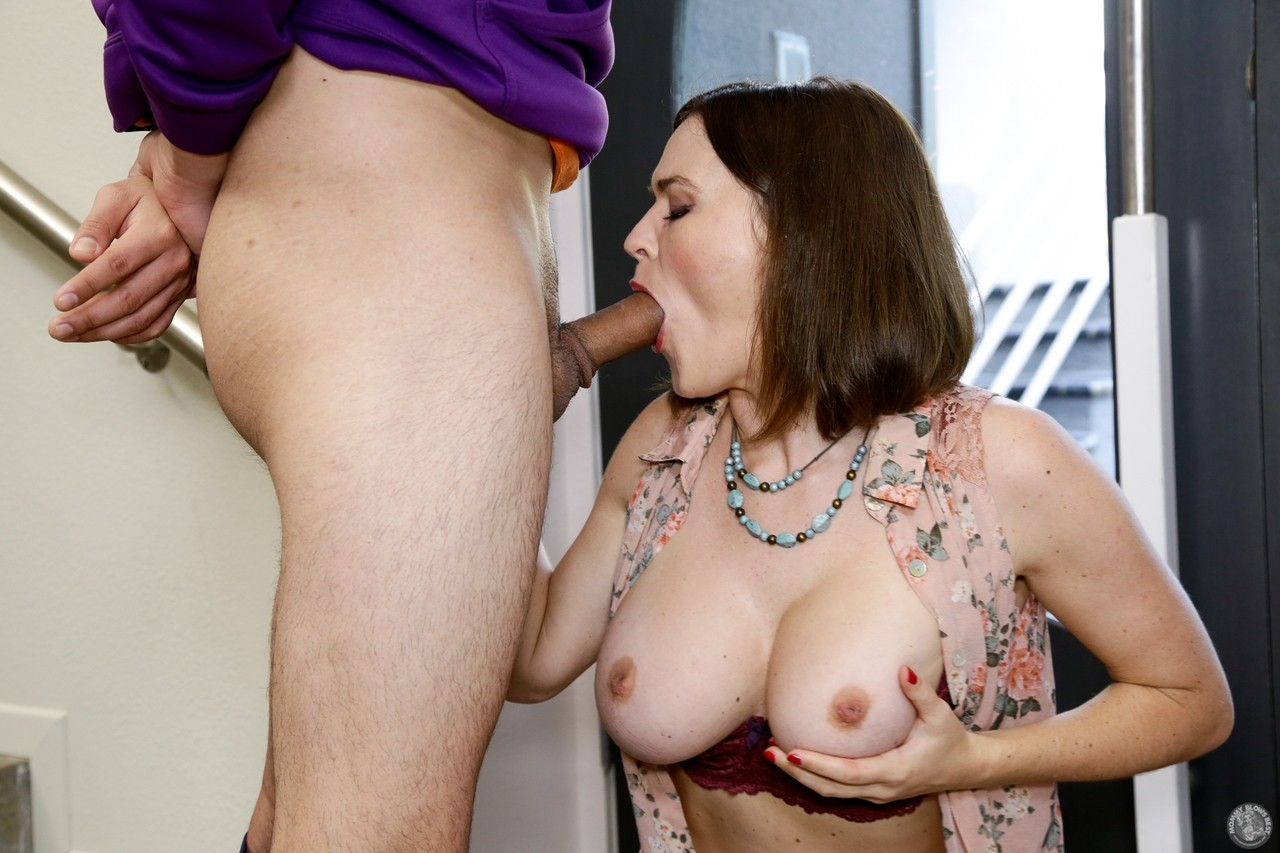Irresistible busty Krissy Lynn gives friends hung son a hot cougar blowjob