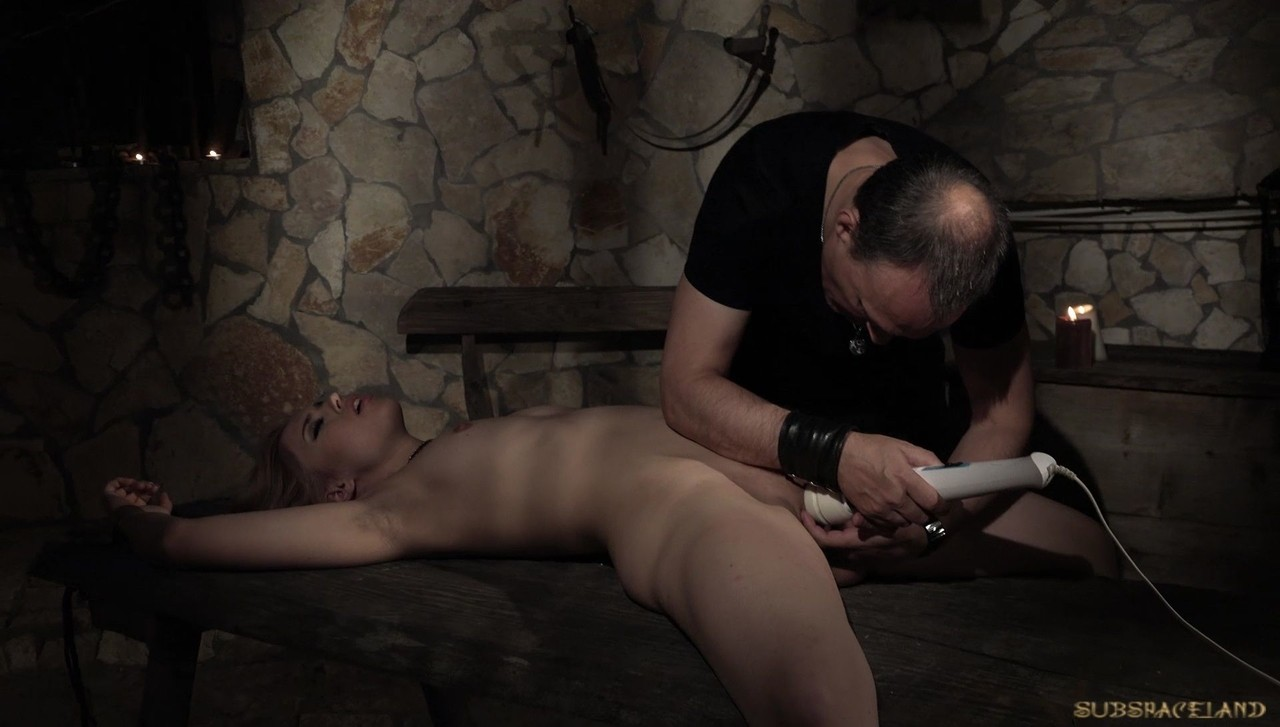 Blonde slave Alana Moon gets her muff toyed up in the dark dungeon