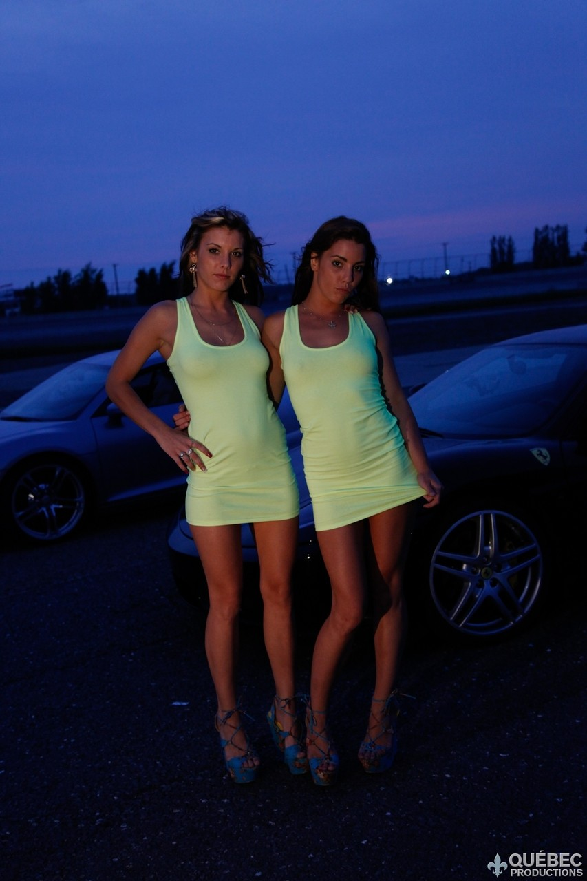Four horny girls are cleaning two sports cars  and posing sexy