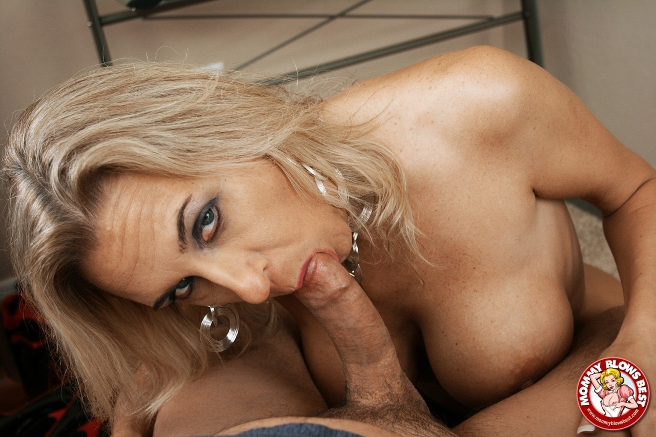 Mature lady Amber Lynn does a striptease prior to a pov blowjob