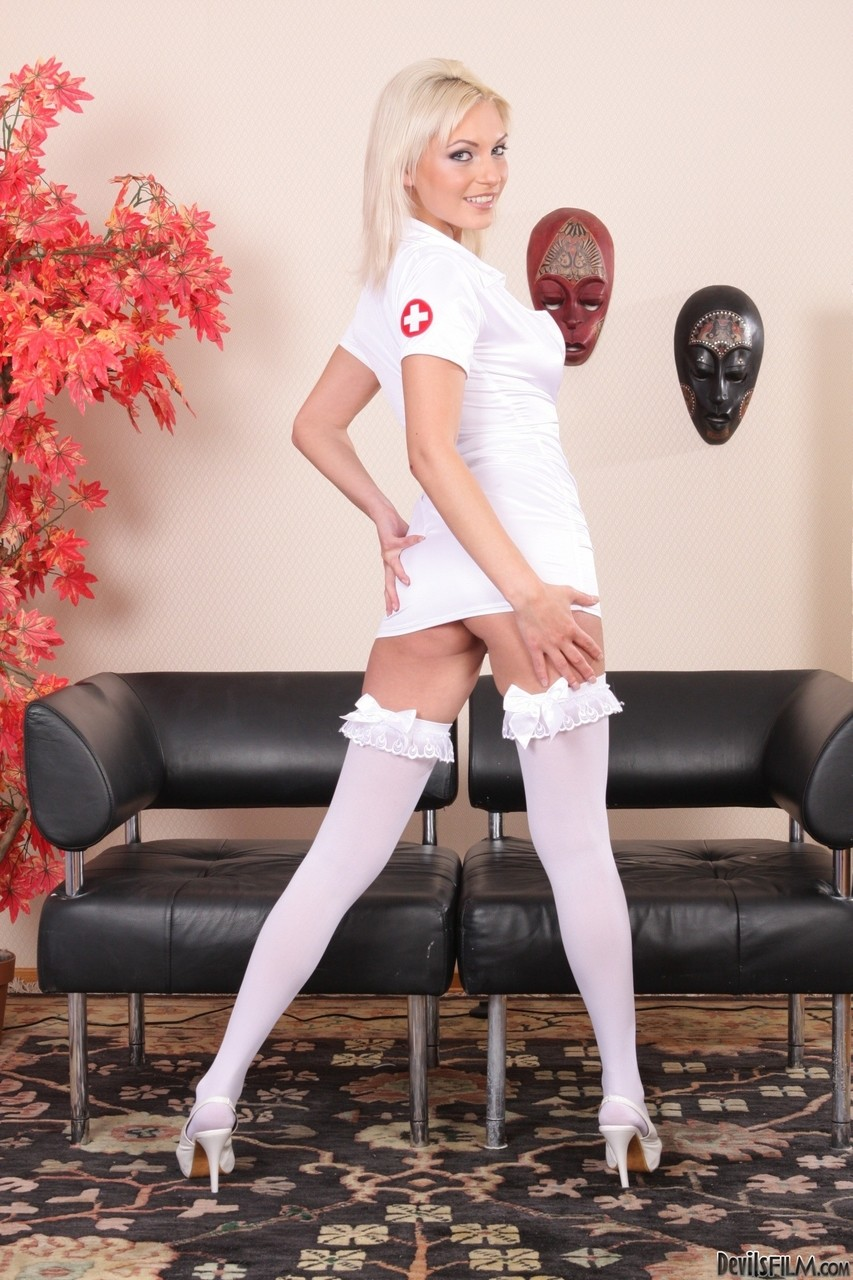Tall hot nurse Alisa A in white stockings sheds uniform to squat & spread ass