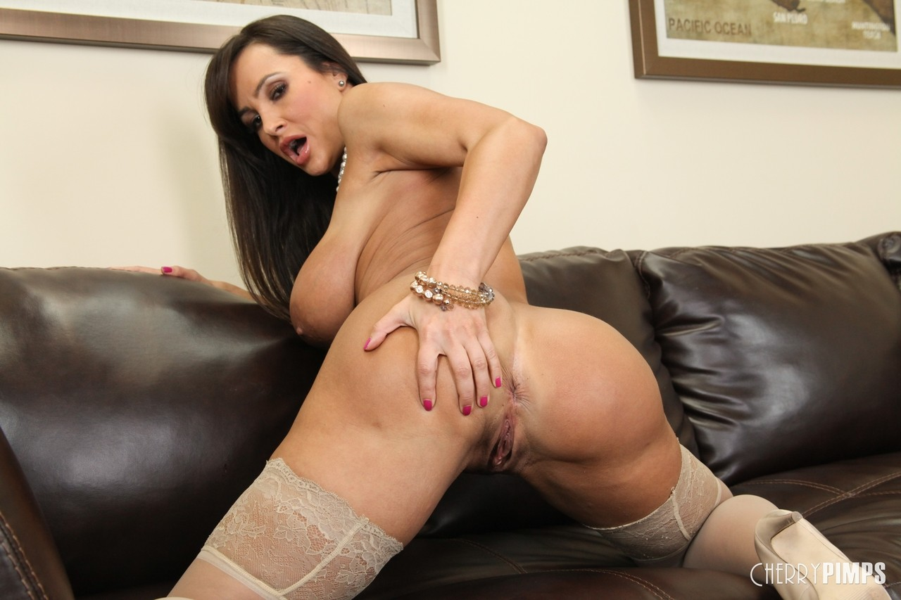 Hottest MILF ever Lisa Ann posing in stockings and showing her remarkable body