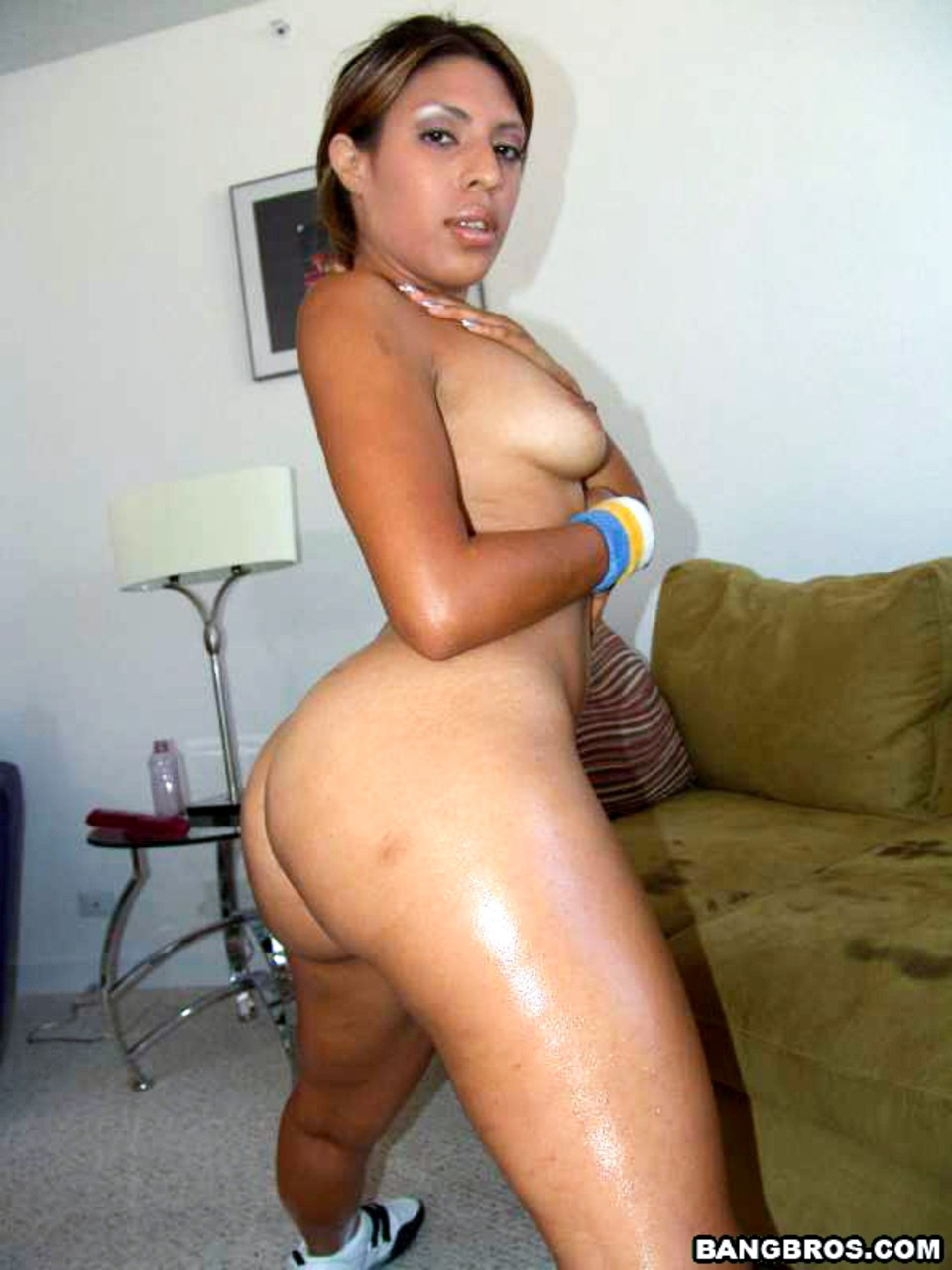 Sizzling Latina Sophia Castello bends naked over the couch to show big booty